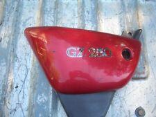 2000-2007 SUZUKI  GZ250 LEFT SIDE COVER