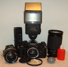 Canon A-1 35mm SLR Film Camera with extras