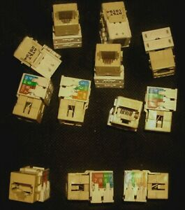 (12) SYSTIMAX M100BH-246 IVORY CAT5 JACKS. USED / EXCELLENT CONDITION. RJ45 DATA