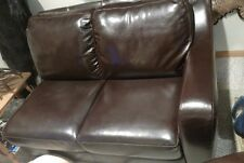 2 person dark brown Leather Couch in perfect condition no rips, no tears.