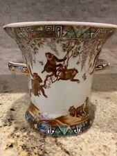 Ceramic planter with monkeys