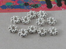 25  rosette in argentone tibetano  da 4 x 0,8 mm