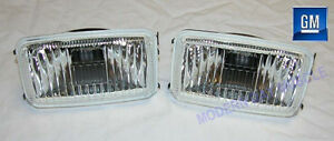 85-90 Firebird Trans Am Front Driving Fog Light Capsule Housings  NEW GM PAIR