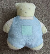 YELLOW TEDDY IN A BLUE PLAYSUIT SOFT WASHABLE RATTLE.13CM TALL X 11CM WIDE X 4CM