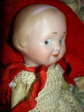 Unusual, German antique bisque 1914 GOOGLY doll by Recknagel, molded pink ribbon