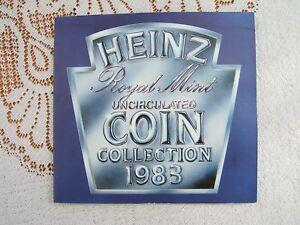 1983 BRITISH  'UNC' SEVEN COIN YEAR SET.  HEINZ FOLDER..................354