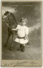 France, Fillette avec cheval de bois, ca.1900, vintage silver print Carte cabine
