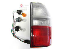 fits: MITSUBISHI L200 K74 1996-2001  NEW REAR R/H LAMP - CLEAR FLASHER LENS