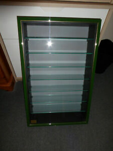 Wooden wall mounted display cabinet model trains & Cars painted green and gold