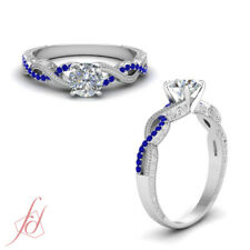 Vintage Round Cut Diamond And Sapphire Gemstone Twisted Engagement Ring 0.60 Ctw