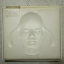 Spiritualized - Let It Come Down OPM 001 Plastic casing with a molding of a girl