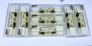 N Scale 7 x Atlas Trainman BNSF 2 bay covered hoppers. Hardly used. Exc Cond.
