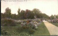 Antique printed & hand coloured postcard View in Italian Garden Broadalbin