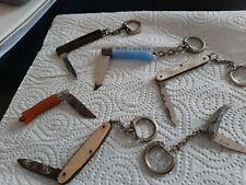 Vintage  lot de 6 portes clés forme couteaux a voir