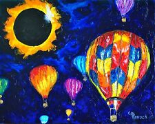Solar eclipse and hot air balloon's. Colorful balloons in 2017