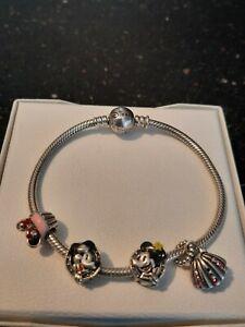 Chamilia Disney bracelet size 19cm with 4 disney charms