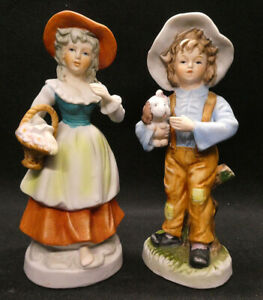Two figurines - women with basket and boy with dog