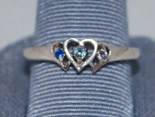 10k White gold ring with hearts and gemstones