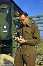 BRITISH 8TH ARMY SOLDIER CHECKS PIGEON CARRIED MESSAGE DURING WWII IN ITALY