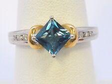 2703-10K TWO TONE GOLD BLUE TOPAZ & DIAMOND RING APPROX 1.28CT 3.90GRAMS SZ 7