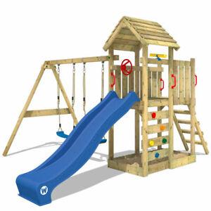 WICKEY Spielturm Klettergerüst MultiFlyer Holzdach mit Schaukel & blauer Rutsche
