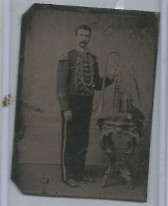 TIN TYPE- SERVICE  MAN STANDING WITH A TROMBONE