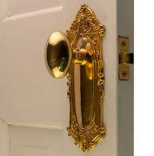 The Milford Passage Set in Polished Brass with Oval Door Knobs