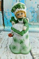 Vintage Porcelain Girl Holding Clover Wear Dress & Bonnet Hat Figurine Bell