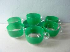 6 tasses à café et leur sous tasse, Arc France, en verre vert, vintage années 70