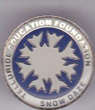 """TELLURIDE EDUCATION FOUNDATION SNOW DAZE"" Enamel Snowflake Pin"