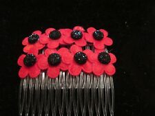 PAIR OF FELT RED POPPY HAIR SLIDES WITH GEM CENTRES ON CLEAR COMBS