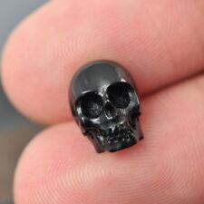 Human SKULL BEAD Black Bovine HORN Bali Carving 10 mm drilled 1 mm hand-carved