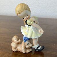 Vintage Porcelain figurine Dog Biting Girls Heel Playing Taiwan