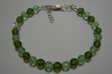 Bracelet made with Swarovski Crystal Rounds: Olivine, Chrysolite + Sterling