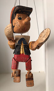 Large handmade painted wooden Pinocchio sitting puppet shelf gift child's room