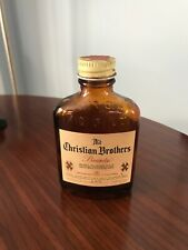 VINTAGE ADVERTISING CHRISTIAN BROTHERS BRANDY BOTTLE EMBOSSED AMBER 1/10 PINT