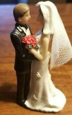 Wedding cake topper bride and groom figurine