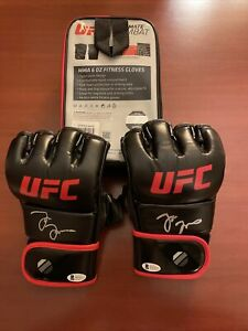 Pair Of Jon Jones Autographed UFC Glove W/ Bag- BAS COA