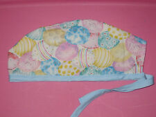 Surgical Scrub Hats caps Easter Eggs in pastel designs on white fabric blue tie