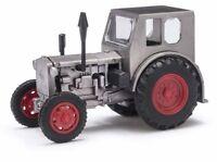Busch 210006404 - 1/87 / H0 Traktor Pionier - Grau / Rote Felgen - Neu