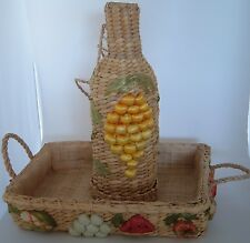 Woven basket with fruit and wine bottle holder with grapes on side Vintage