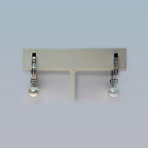 Huggie Pearl Earrings with Baguette Diamonds