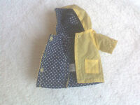 GINNY DOLL RAINCOAT, YELLOW, BLUE DOTTED LINING. TAGGED 1985  EXCELLENT COND.
