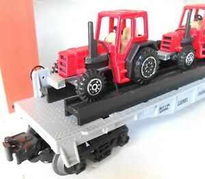 LIONEL  FLATCAR WITH THREE DIECAST FARM TRACTORS   N/BOX  3-PICTURES  6-16907