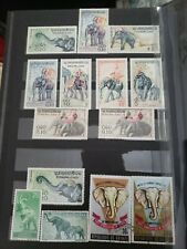 World Stamp stock book postage elephant set and Laos