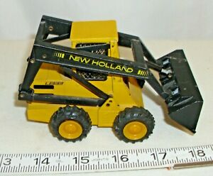 NZG HEW HOLLAND L555 SKID LOADER CONSTRUCTION MODEL DIECAST TOY NO. 275 1/25