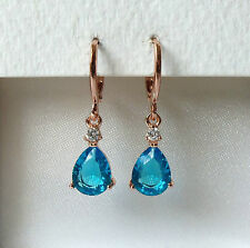 Rose Gold Plated Blue CZ Pear Drop Earrings, 28mm x 7mm.
