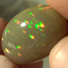 24.18 ct See the Effect of Relative Humidity on an Ethiopian Opal ( See Videos )