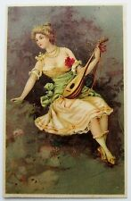 Tuck #2182 Lovely LADY Woman Plays MUSIC Early UDB Postcard