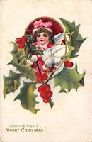 Merry Christmas wish c1910 Postcard Girl Child with Presents Holly